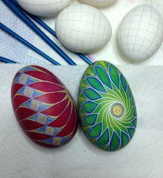 Spiral/pinwheel design (goose eggs).  Can make green/blue one into a peacock design