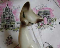 Tall 1950s Siamese cat figurine. Naturalistic colours but typical Mid-century stylised elegant elongated shape.
