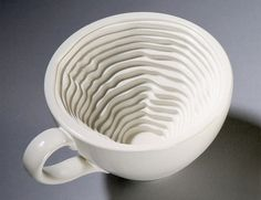 awesome. this set of tableware by designer iohanna pani uses statistical data to generate its forms. the 'form follows data' collection embeds personal statistical data into everyday objects altering their design in the process. the coffee mug was designed to represent the amount of coffee consumed daily represented through a topographical map inside.
