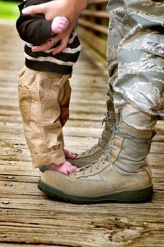 father and son army boots and bare feet