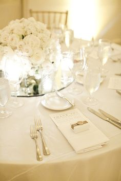 Mirror in the middle of table with centerpiece and candles