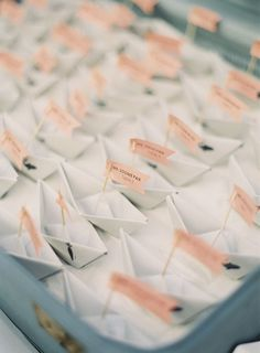 Wedding Escort Cards | Caroline Tran Photography via Style Me Pretty | Paper boat origami tutorial | #WeddingEscortCards