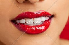 close-up image of a young female wearing red lipstick. - macro shot of a young Indian female wearing red lipstick, Kiran Bahugun