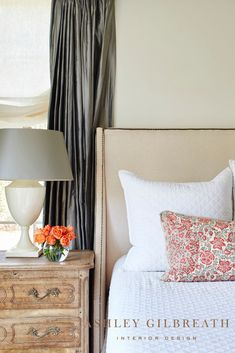 ASHLEY GILBREATH INTERIOR DESIGN: This bedroom is all about texture! A neutral upholstered nailhead headboard provides a soothing backdrop for a diamond matelassé coverlet and geometric pillow. Flanked by layered slate grey silk curtains and a linen roman shade, this bedroom is what dreams are made of. Romantic Master Bedroom, Small Master Bedroom, Master Bedroom Design, Big Pillows, White Pillows, Ashley Gilbreath, Nailhead Headboard, Big Beds, Thing 1