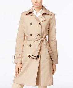 Protect yourself from the rain and sleet with this fashionable petite trench coat from Calvin Klein. | Shell & lining: polyester | Machine washable | Imported | Wing collar with hook-and-eye closure |