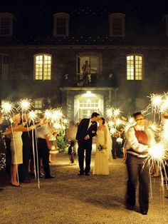 The Grand Exit    Sparklers like these make for a beautiful nighttime exit as you wave farewell to your friends (and the photographer!) and head off with your new husband.