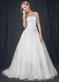 Perfect for the princess bride, this traditional gown offers all the glamour of true royalty. Strapless satin bodice is accented with intricate beaded metallic embroidery and elegant lace-up back. Full tulle ball gown skirt creates drama and features embroidery to complement the bodice. Figure-flattering silhouette is great for all shapes and sizes. Chapel train. Available without train as style NTWG9927, $749 (special order only). Fully lined. Imported polyester. Dry clean only. White also…