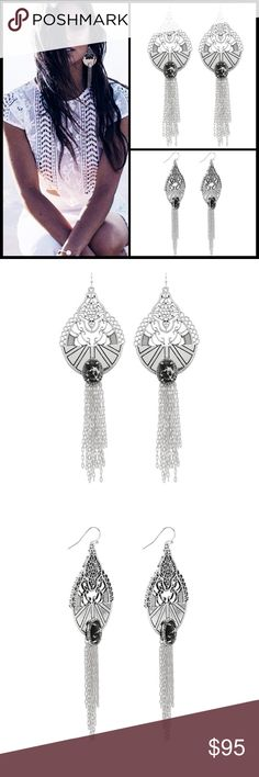 SAMANTHA WILLS  ADD UNDENIABLE LUXE GLAMOUR TO YOUR OUTFIT WITH THE NEWEST GRAND EARRINGS FROM SAMANTHA WILLS. FROM THE SHIMMERING CHAIN TASSEL TO THE INTRICATE FILIGREE LACEWORK, THE ORNATE DETAILING OF THE WILDEST DREAMS GRAND EARRINGS WILL CAPTIVATE YOU FROM THE FIRST WEAR.   - DRAMATIC DROP DESIGN IN A SILVER-TONE FINISH  - EARRING LENGTH/WIDTH: 140mm/45mm  - HOOK BACKING  - OVAL CUT BLACK MARBLE STONE SURROUNDED BY A HALO OF CRYSTALS  - SILVER-TONE CHAIN TASSEL  - ENGRAVED W SAMANTHA…
