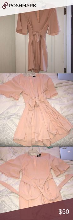 This is a NEVER WORN light pink romper!! This is a light pink romper that has never been worn! Very cute and the perfect outfit for the summer!! Lulu's Other