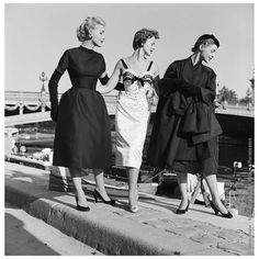 Models in Dior - Pont Alexandre lll. Captured here in 1953 at Paris' Pont Alexandre III are three models strolling the bridge's adjoining quay in Dior couture.