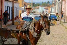 man with horse in Trinidad cuba