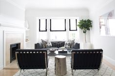 White Roman Shades with a black border look stunning paired with a gray couch and black chairs in Caitlin Flemming's living room design. Living Room Designs, Living Spaces, Living Rooms, Living Room Furniture, Living Room Decor, Living Room Windows, Living Room Inspiration, Interior Inspiration, Decoration