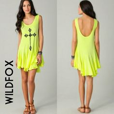 WILDFOX Gothic Cross dress/tunic   Beautiful yellow tank dress/tunic with black Gothic cross. Low scoop neck in back. Asymmetric hem. Very flowy. Excellent condition... No stains, flaws, or tears. Worn once. Wildfox Dresses Mini