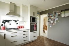 Never lose postcards and photos with Resene Magnetic Magic paint on the feature wall in grey/brown Resene Half Masala. New Kitchen, Kitchen Decor, Resene Colours, Colour Schemes, House Painting, Sliding Doors, House Colors, Brown And Grey, Lounge