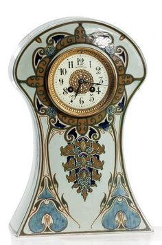 Clock in faience casing in Art Nouveau style The Hague/Netherlands, 1900-1914, cream dial with signature 'Rozenburg Holland', Underneath Rozenburg mark Movement numbered '2967' and marked 'Japy Frères', 38 x 24 x 9 cm