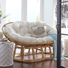 All the appeal and comfort of our iconic Papasan Chair—and then some. With room for two, it's twice as nice with a double-bowl frame. Still handcrafted of natural rattan, then finished with a rich, brown lacquer. This Papasan is double the fun.