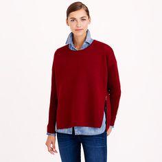 Bonded wool (when two layers of the fabric have been bonded together, giving the piece structure <i>and</i> polish) meets cool-girl, oversize hardware—because everything is just a little bit better with zippers. Wear them unzipped to let a pop of color peek through. <ul><li>Oversize fit.</li><li>Hits below hip.</li><li>Merino wool in a 12-gauge knit.</li><li>Rib trim at cuffs.</li><li>Dry clean.</li><li>Import.</li></ul>