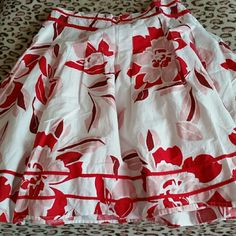 Beautiful skirt Red, white, light pink colored, right above knee skirt. This looks awesome with my red sweater i have for sale.  Put a pair of boots its so cute in summer or winter!!! Connection 18 Skirts