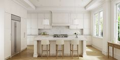 A shaker style kitchen with Sub-Zero and Wolf appliances, marble stone work and tall ceilings