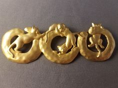 """Vintage JJ Gold Tone Cat Brooch. Measures about 3"""" by 1"""""""