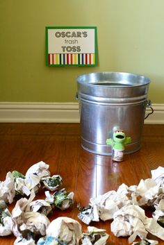 Oscar's Trash Toss was incredibly easy to set up – just a metal trash can with crumpled up junk mail for kids to toss into the bucket.  It was such fun to watch them play this game!