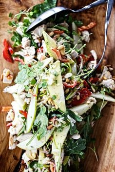 Warm chicken salad with peppers, pears and roasted pine nuts. (or toasted pecans)