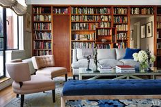 Jay McInerney and Anne Hearst's Manhattan Home | In the living room, a pair of Duane Modern slipper chairs upholstered in a Holland & Sherry linen join a 1970s chrome bench in a Glant chenille and a Roman Thomas sofa in a Rogers & Goffigon linen. The bronze nudes are by Harriet W. Frishmuth, and the vintage Danish floor lamps are from Dienst + Dotter Antikviteter | Grey, pink, blue, brown.