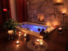 We have a Jacuzzi bath in our new home, with a flat area around it similar to this. I like the idea of candles surrounding it, being when I need to relax the Jacuzzi is where I'm at.The candles would make it that much more relaxing. Romantic Bathrooms, Dream Bathrooms, Amazing Bathrooms, Romantic Home Decor, Romantic Homes, Romantic Night, Romantic Places, Home Interior, Interior Design