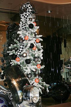 Christmas tree decorated with Harley Davidson ornaments. Its not weird to put a Christmas tree in the garage, is it??