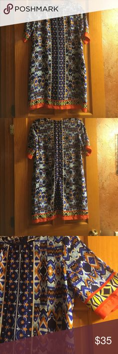 Collective Concepts Patterned Dress Collective Concepts Patterned lined Dress 🔹🔸 Size: XS Beautiful orange, blue, white & green pattern! Feels almost silk like is 100% polyester! Functional zipper down the back! Perfect condition!! Collective Concepts Dresses