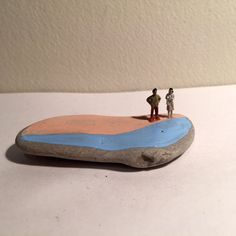 These small handpainted rocks feature sweet people going about their day on the rock bluffs. Each one is completely unique. Their approximate size is 2 x 2. Custom orders are always welcome.