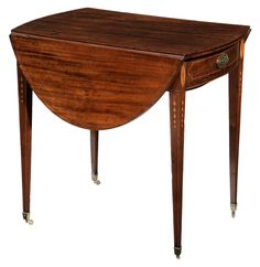 Fine and Rare Southern Federal Bellflower and Urn Inlaid Mahogany Pembroke Table attributed to Charleston, South Carolina, circa 1800, line-inlaid oval top with drop leaves, single line inlaid bow-front drawer flanked by urn and floral patera and set on finely tapered legs with line and descending bellflower chain inlay, set on brass casters, white pine, red cedar and cherry secondary, 28-3/4 x 30-1/4 x 41-3/4 in. open, 20-3/4 in. closed