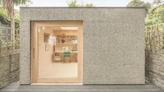 This cork-clad studio provides a shared workspace for a musician and a seamstress in the back garden of their north-London home.