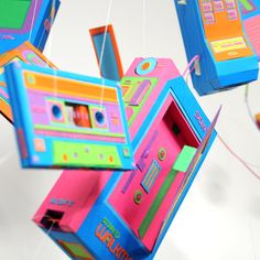 Retro-tech makes for undeniably good eye-candy. Especially when crafted from wonderfully childlike, neon paper by a pair of stupidly talented young artists...