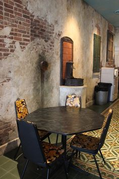 Restaurant distressed walls with traditional cement floor tiles