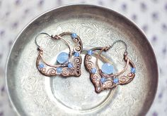 Wire wrapped copper earrings with blue quartz  by SabiKrabi, $60.00