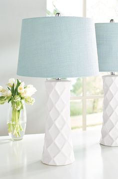 Two is better than one in many a room design, and so our Savannah Table Lamps are prettily paired. The patterned base design adds a lovely touch for a traditional or transitional setting, whether for a console, bedroom, or sitting area.