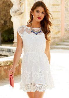 Alexandra Lace Dress would look cute with leggings or jeans, and a fitted blazer that hits at the hip.
