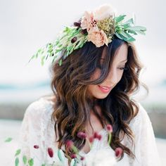 The beautiful bride wore a flower crown of English roses carnations berries and wheat.  To see more boho-chic wedding details from this wedding click the link in our bio! | : @aliciaswedenborg #marthaweddings #flowercrowns #weddinginspo via @angela4design