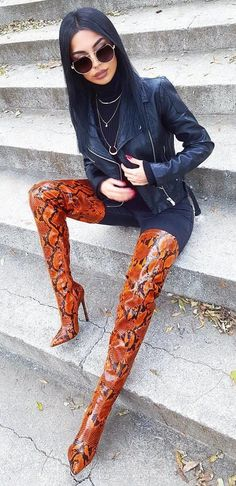#fall #outfits women's black leather zip-up jacket and brown-and-black snakeskin leather thigh-high heeled boots #highheelbootsthigh