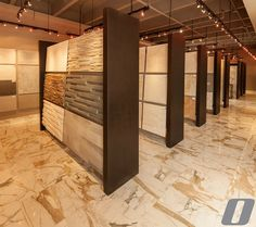 Our Opustone Showrooms display the versatility and beauty of tile concepts. Proof positive you will gind a design that captures the warmth elegance and style you desire  #opustone #stone #naturalstone #tiles #surface #homedesign #houzz #interiordesign #architecture #archilovers #interiors #marble #unique #interiorlovers #homegoals #miami #art #decor #homedecor #modern #luxury #luxuryhomes #custom #design #picoftheday #trending #shapes #textures #elegance #calacattamarble