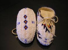 Beaded Baby Moccasins by Dr. Eli Bear Shield, Sioux made of Elk Hide.