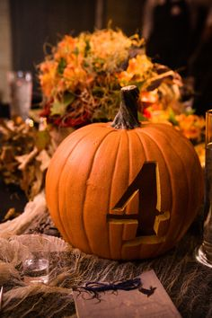 Very awesome pumpkin table numbers! Maybe with small pumpkins