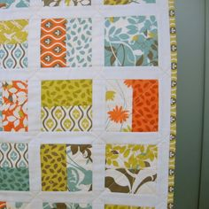 Modern baby quilt. love Love LOVE this layout. The white sashing makes it dance. Sew perfect for jelly rolls or charm packs. Using charm packs, pick two and lay them RST. Sew 1/4 seam only on the two vertical sides. Cut them in 1/2 parallel between the seams and you have an instant block!.