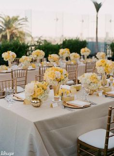 Gorgeous wedding color scheme! The yellow flowers create such a bright and fresh look.