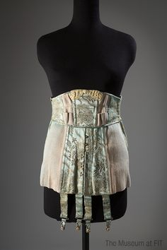 Corset by Strouse, Adler Company, circa 1920. #lingeriehistory Collection of The Museum at FIT. /   By the early 1920s, comfort and modernity had become crucial to corset design. Many corsets (now also called girdles) had elastic panels that allowed for greater freedom of movement.