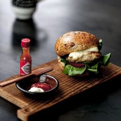 Small Grilled fish burger in one bite with TABASCO Miniatures.