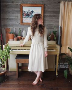 A lovely beige wool dress with matching belt. High ribbed neck & long sleeves. Maker: Ciao Ltd.  Vintage Size: 10 ( small )  Measurements:
