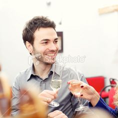 Young man toasting during an italian aperitif Royalty Free Stock Photo