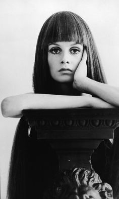 1967: While Twiggy's signature pixie cut is the look for which she's best known, the beautiful Brit was such a chameleon that she rocked this severe fringe wig for 'Daily Express.'